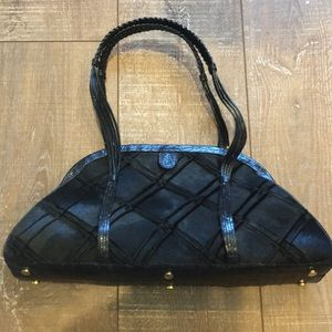 Nancy Gonzalez black Pony and crocodile bag